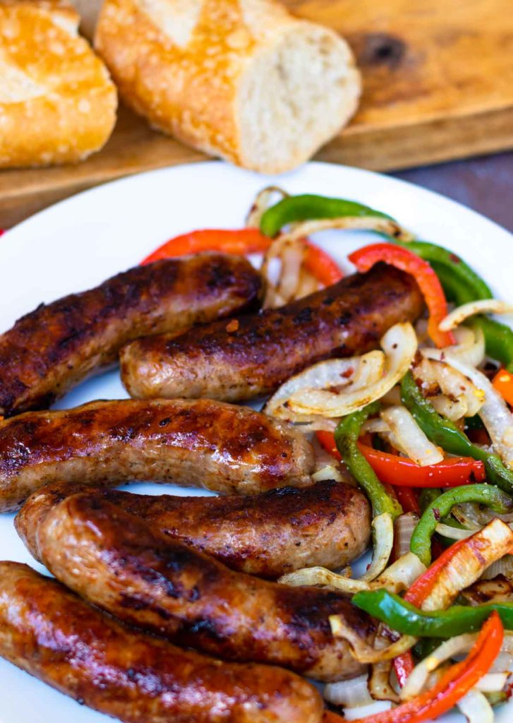 This classic combination of Grilled Sausage, Peppers and Onions is totally easy to make and delicious. Made with mild Italian sausage, sliced red and green bell pepper and yellow onions seasoned with salt and pepper and cooked on the grill.