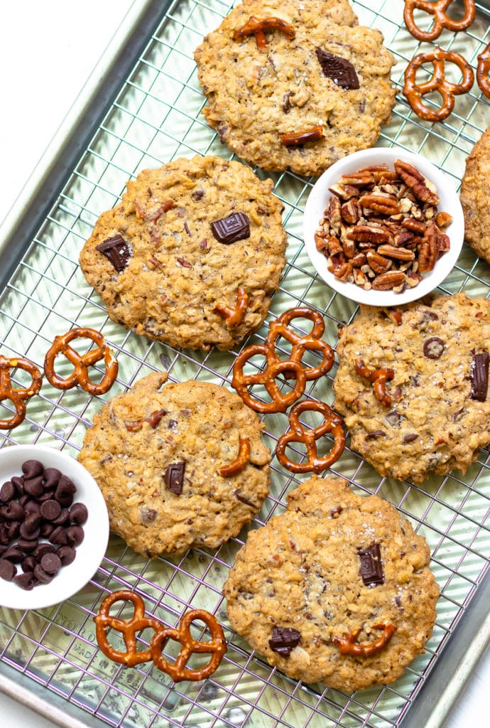 Kitchen Sink Cookies are loaded with sweet, savory and salty goodness! Made with butter, sugar, flour, oats, dark chocolate, chocolate chips, coconut, pecans and pretzels. This is one cookie that that has something for everyone!