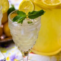 Homemade lemonade is refreshing and so easy to make. Fresh squeezed lemon juice sweetened with simple syryp made from sugar and water with a little water and poured over ice mades a delicious drink perfect for any time of the year.
