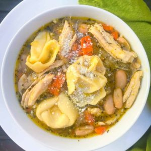 Homemade Chicken and Cheese Tortellini Soup is hearty and so easy to make. Made with rotesseri chicken, cheese filled tortellini, white beans, carrots, celery and herbs in a store bought broth.