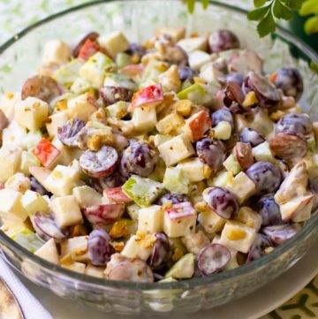 Waldorf Salad is a classic recipe that's great served any time of the year. Made with red and green apples, red seedless grapes, celery and walnuts. They are all tossed in a dressing of mayonnaise, sour cream, sugar and lemon juice.