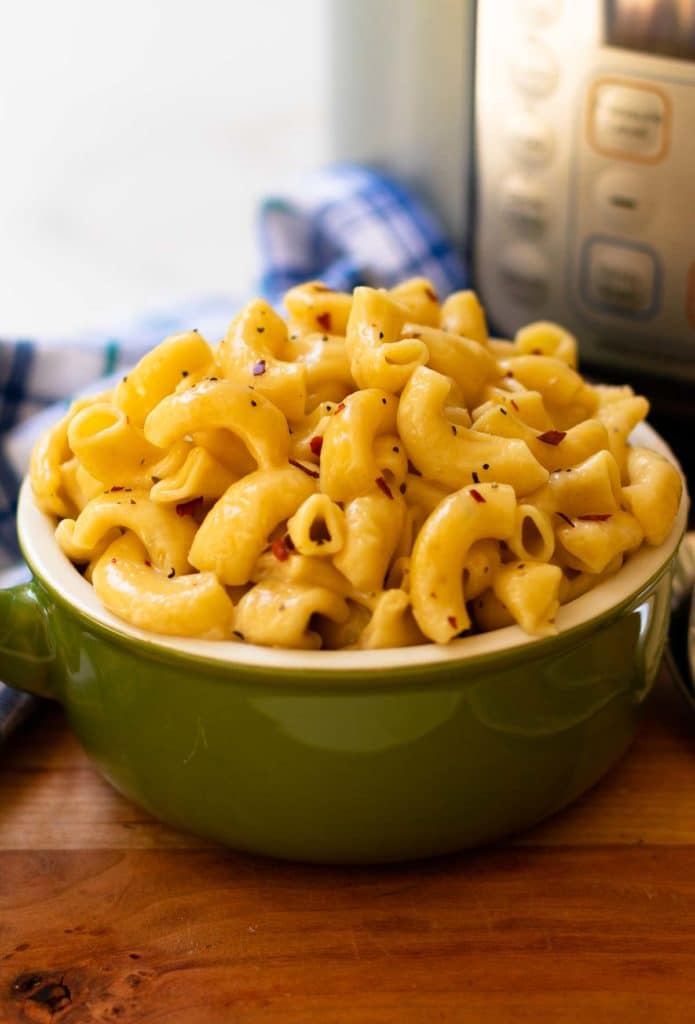Pepper Jack Mac and Cheese in green bowl made in Instant Pot