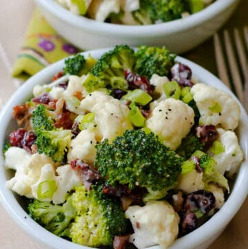 Broccoli Cauliflower Salad in bowl upclose.