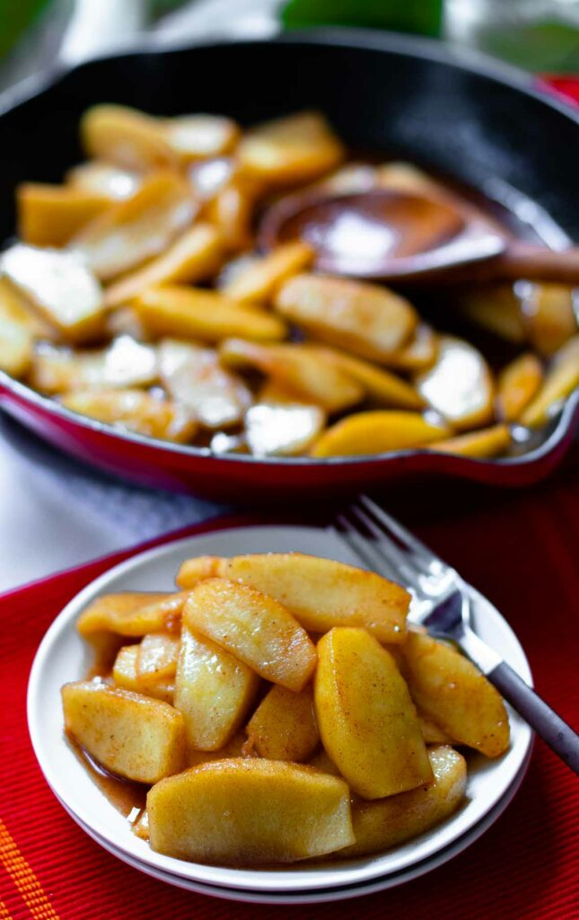 Apples cooked in a cast iron skillet with brown sugar, butter and cinnamon.