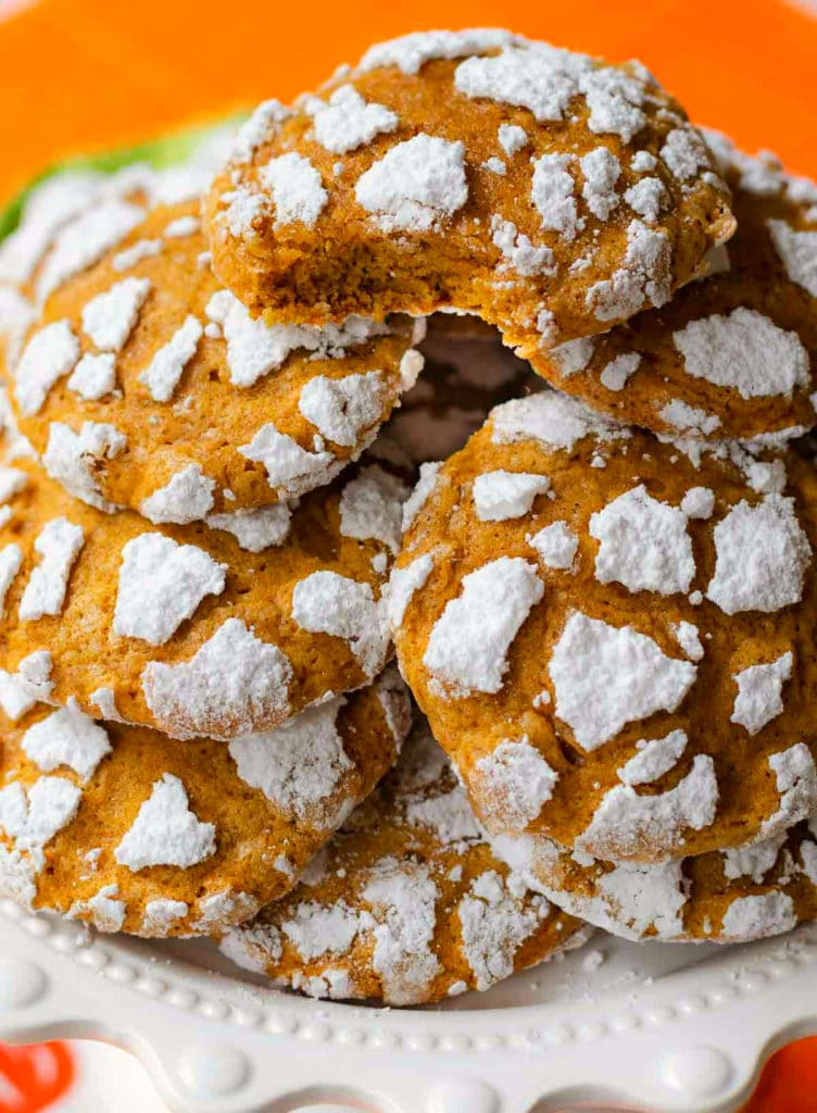 Pumpkin Crinkle Cookies with powdered sugar are everyone's favorite fall treat!