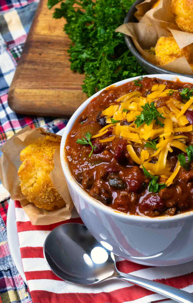Award Winning Southern Soul Chili with cheese, parsley and corn bread muffins.