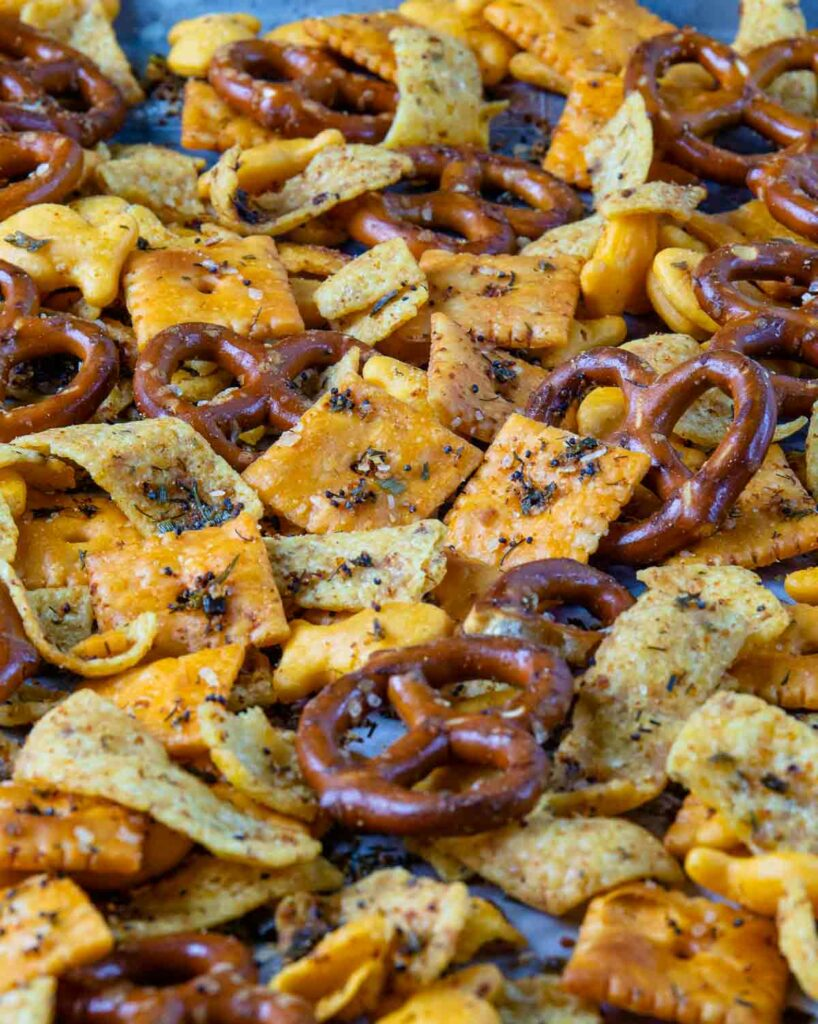 Spicy Cheese Cracker Snack Mix with pretzels on a sheet pan.
