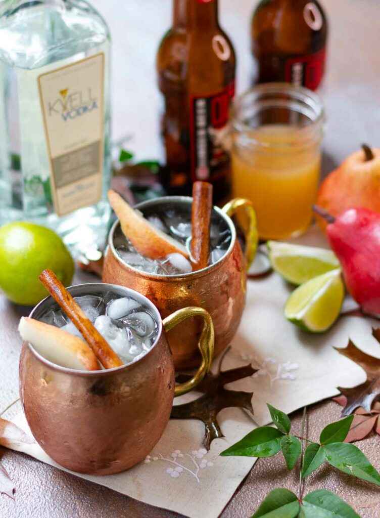 Spiced Pear Moscow Mule drink with lime, simple syrup, Kvell vodka and ginger beer.