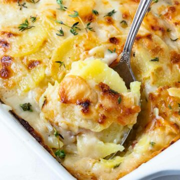Beautifully golden and perfectly cooked Scalloped Potatoes in a casserole dish.
