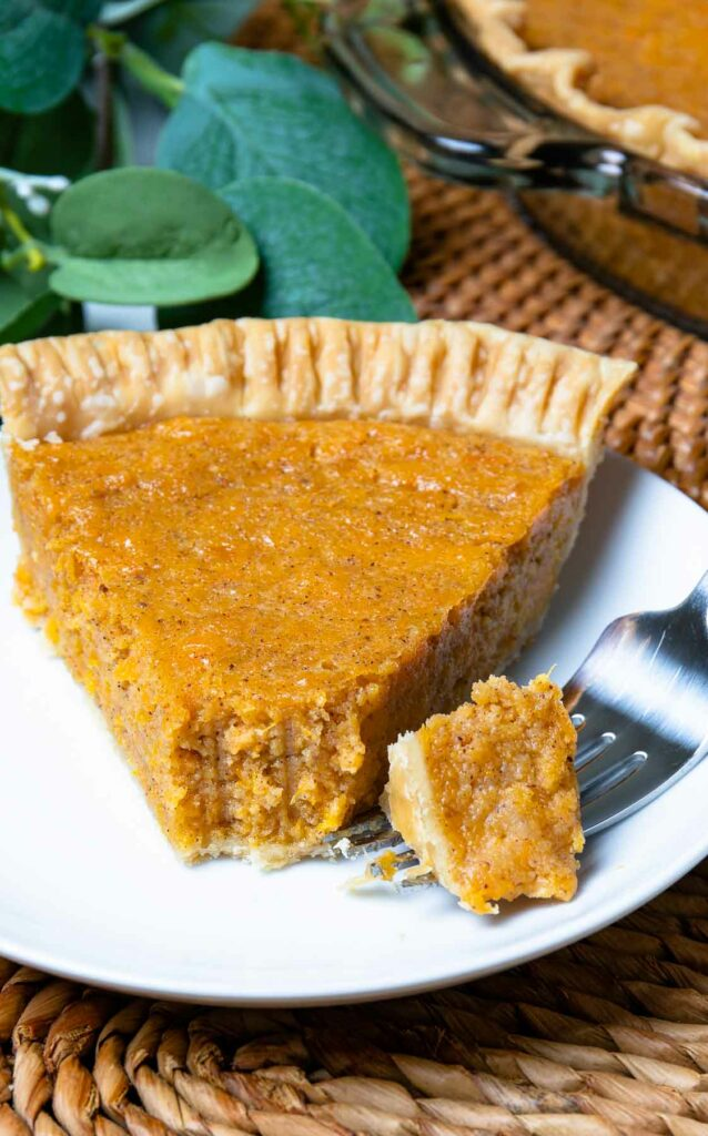 Slice of classic Sweet Potato Pie with a fork for dessert.