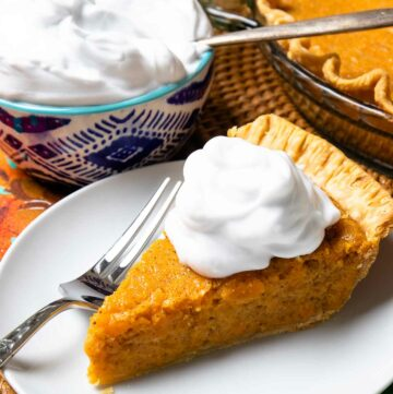 Classic Sweet Potato Pie with fresh whipped cream is an easy to make desssert.