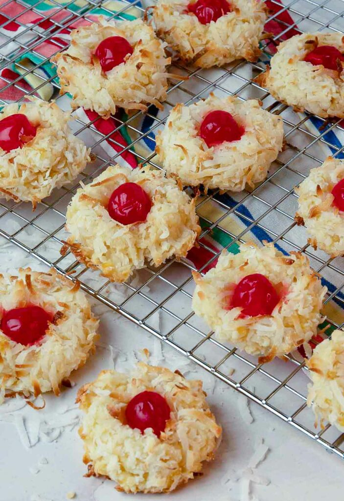 Ambrosia Cookies made with cherries, coconut and pineapple cooling on a rack.