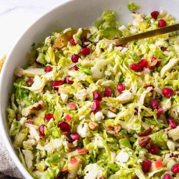 Brussels Sprouts Slaw in a bowl to serve as a side dish any time of the year.