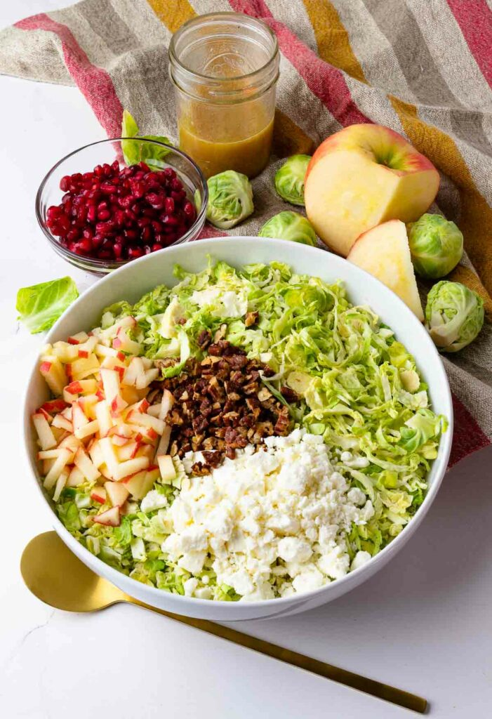 Brussels Sprouts Slaw with pomagranet, apples, pecans and dressing.