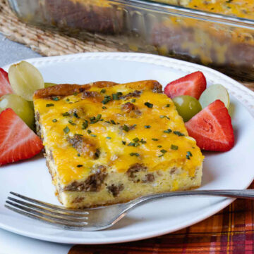 Sausage and Egg Breakfast Bake served with fresh fruit for breakfast.