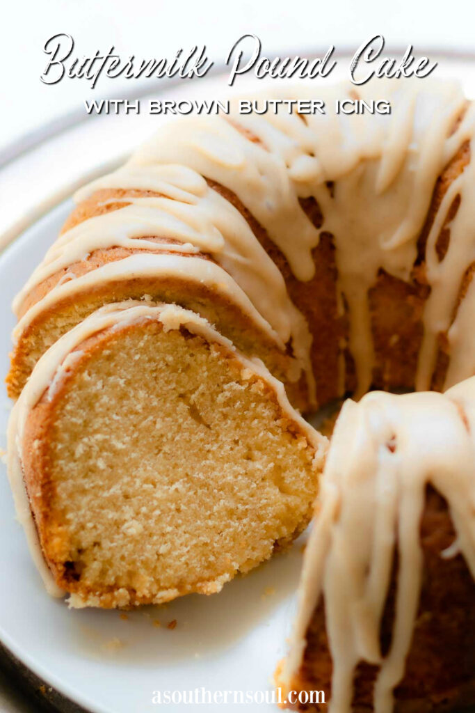 Buttermilk Pound Cake with brown butter icing on a plate with a silver cake cutter.
