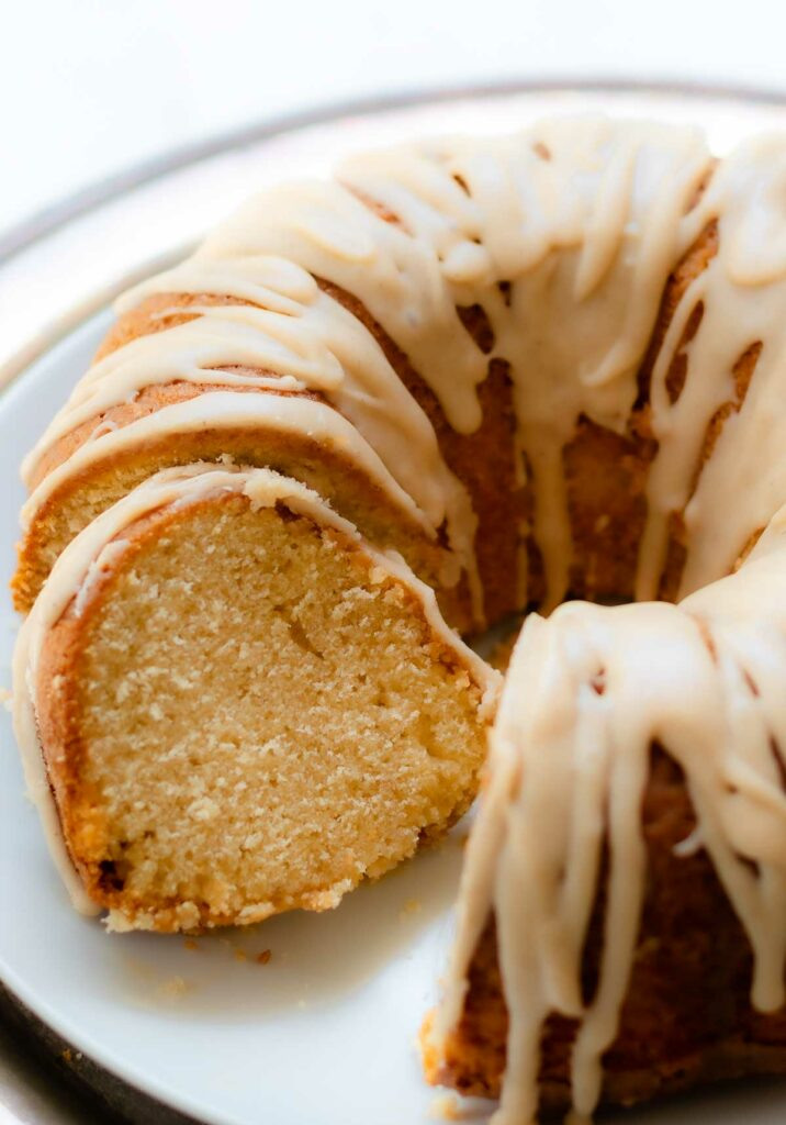 Buttermilk Pound Cake with brown butter icing sliced on a cake plate.