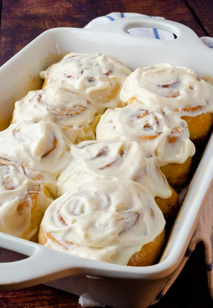 Easy Cinnamon Rolls in a white pan with cream cheese icing.