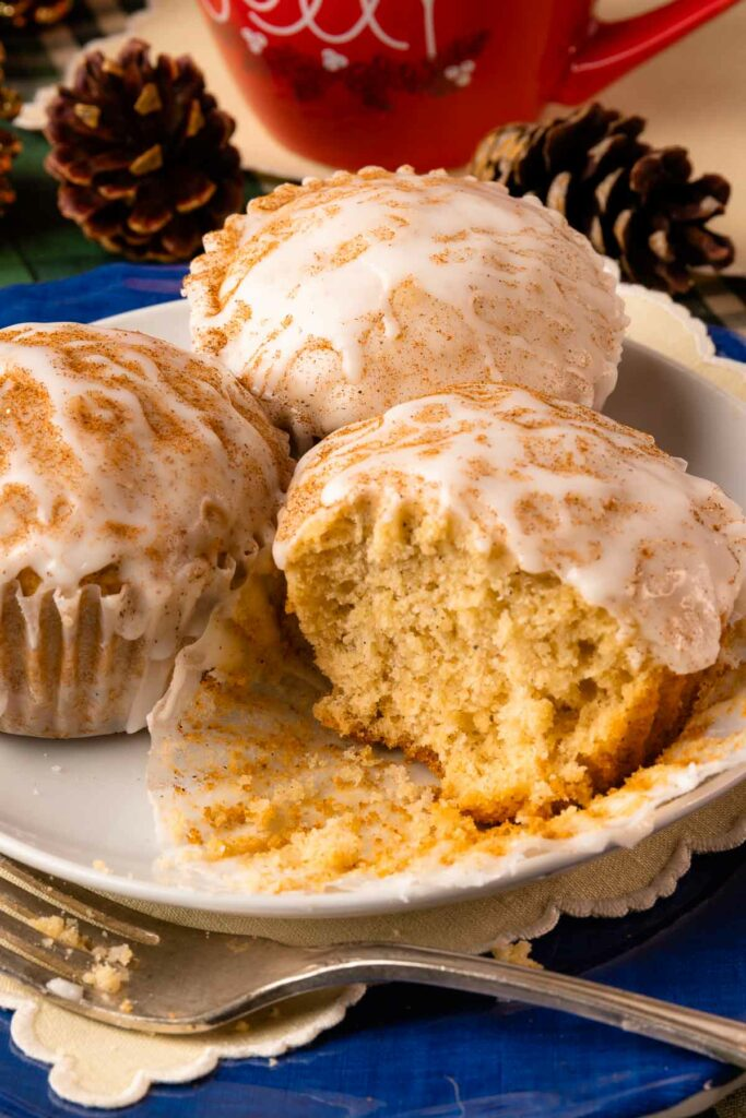 Eggnog Muffins on a plate with fork and cut in half.