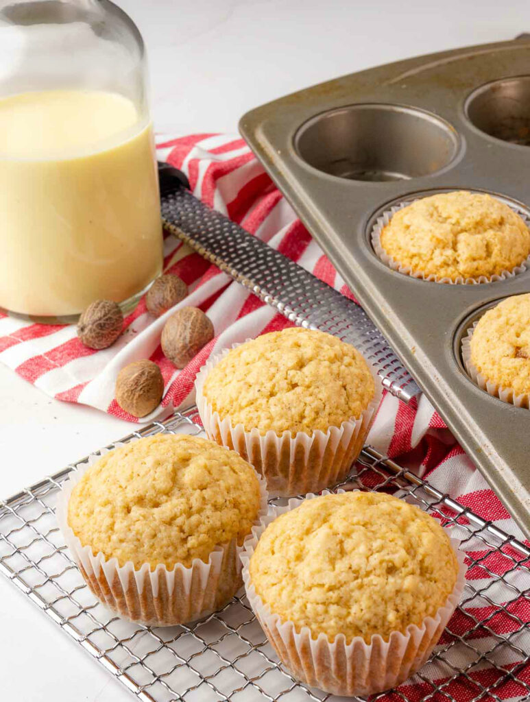 Eggnog Muffins on a muffin tin unglazed.