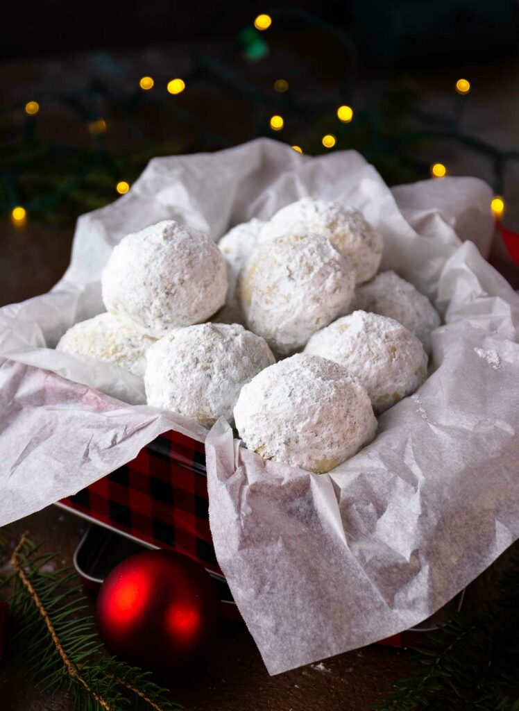 Snowball Cookies in a metal tin for gift giving at Christmas.