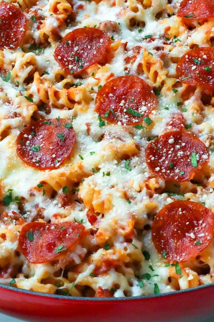 Close up of Pizza Pasta Bake with Parmesan Cheese and Pepperoni.