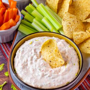 Southwest Ranch Dip served in a bowl with veggies and tortilla chips.