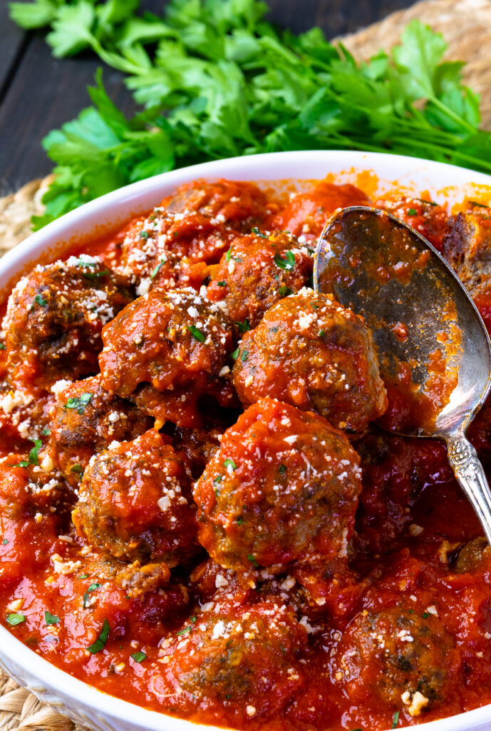 Homemade Meatballs in a easy to make tomato sauce in a bowl with a spoon.