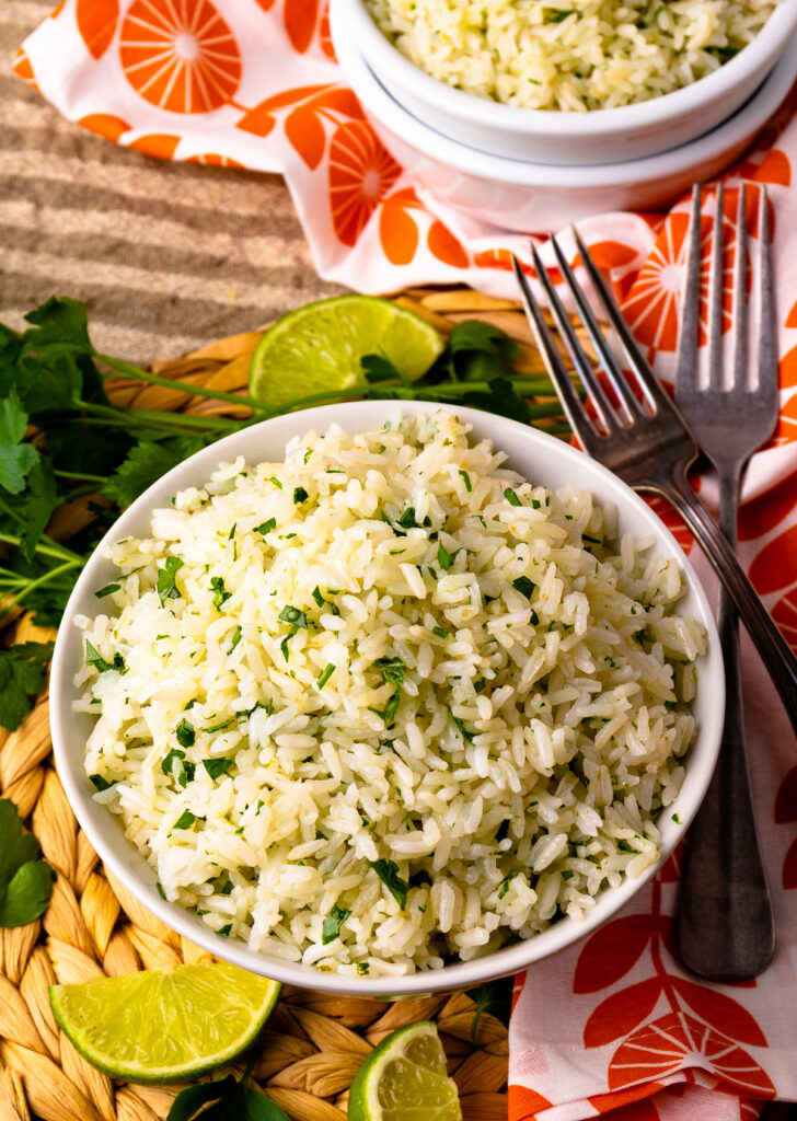 Instant Pot Coconut Lime Rice in a white bowl with forks.