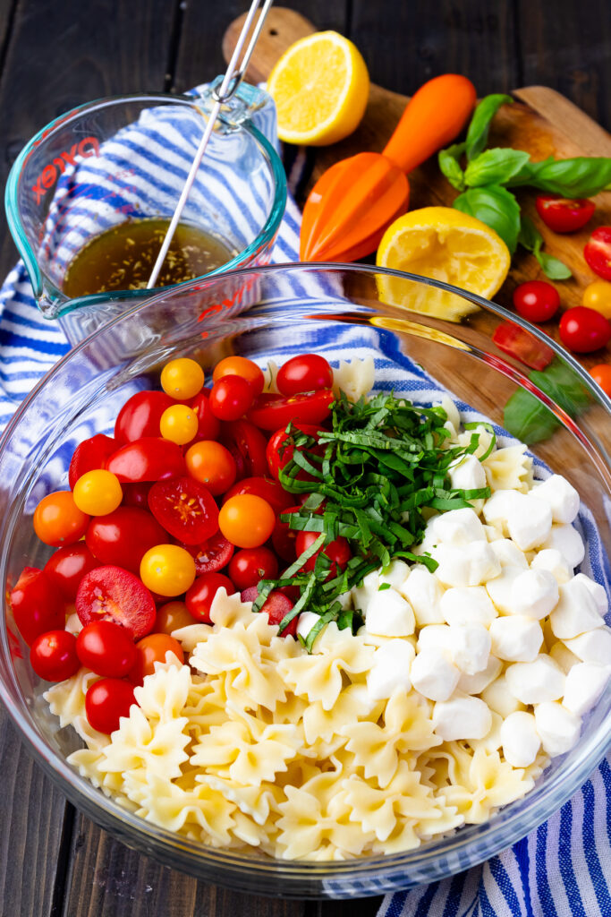 Fresh ingredients make Caprese Pasta Salad with a light dressing easy to make.