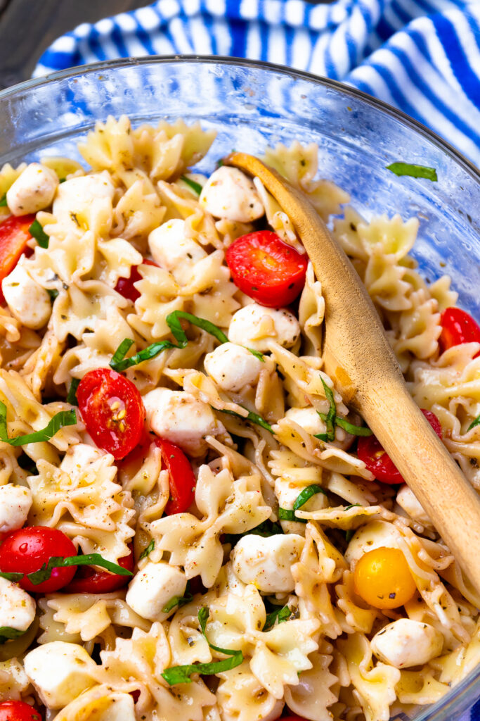 Easy to make Caprese Pasta Salad has fresh tomatoes and basil in a light dressing.