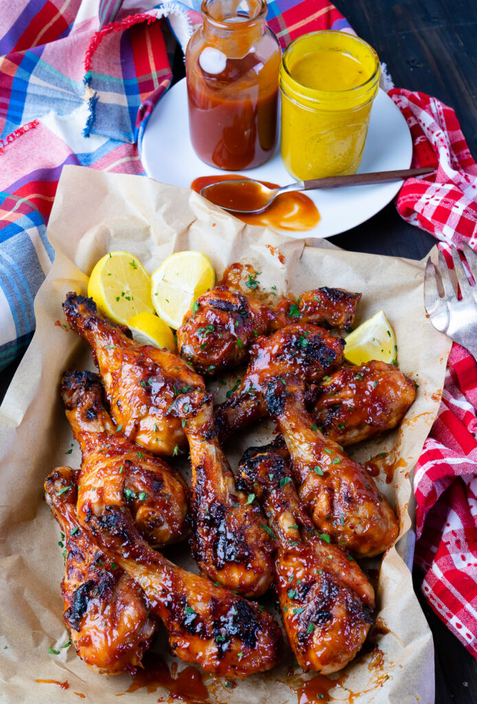 Grill BBQ Chicken Legs with homemade sauce and Carolina Gold Sauce.
