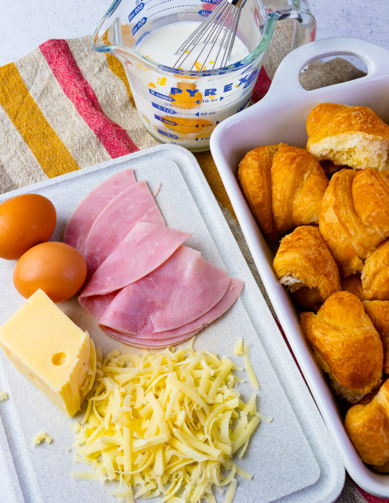 Ham, cheese, eggs and croissants for Ham and Cheese Croissant Breakfast Casserole