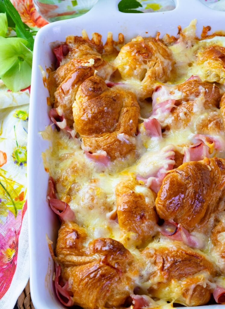 Ham and Cheese Croissant Breakfast Casserole in a white baking dish for breakfast or brunch