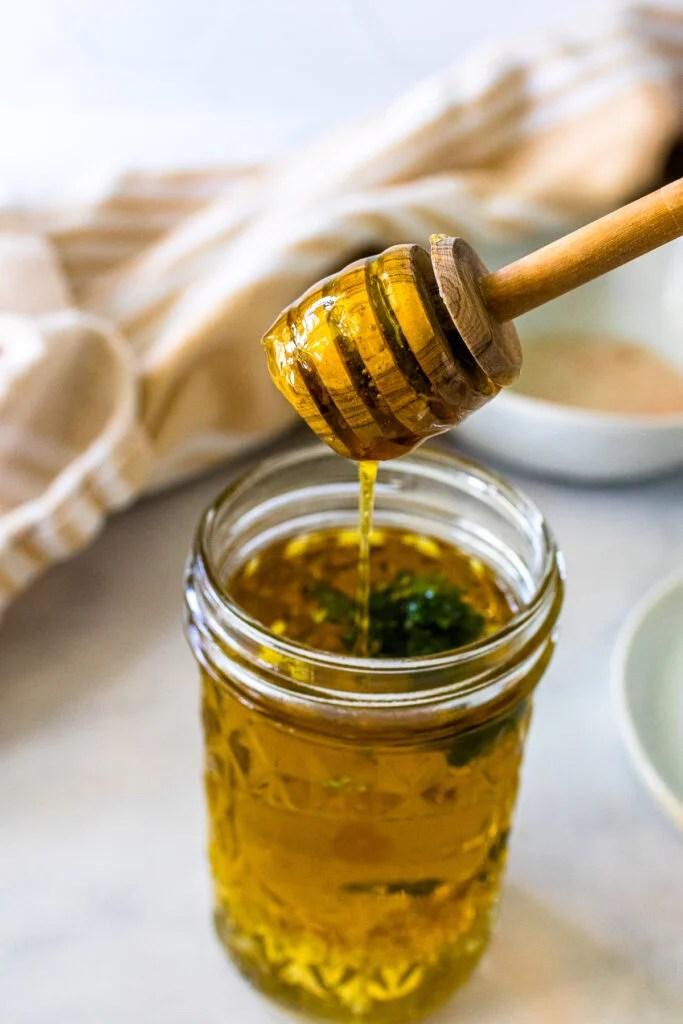Homemade vinaigrette with honey for antipasto skewers.