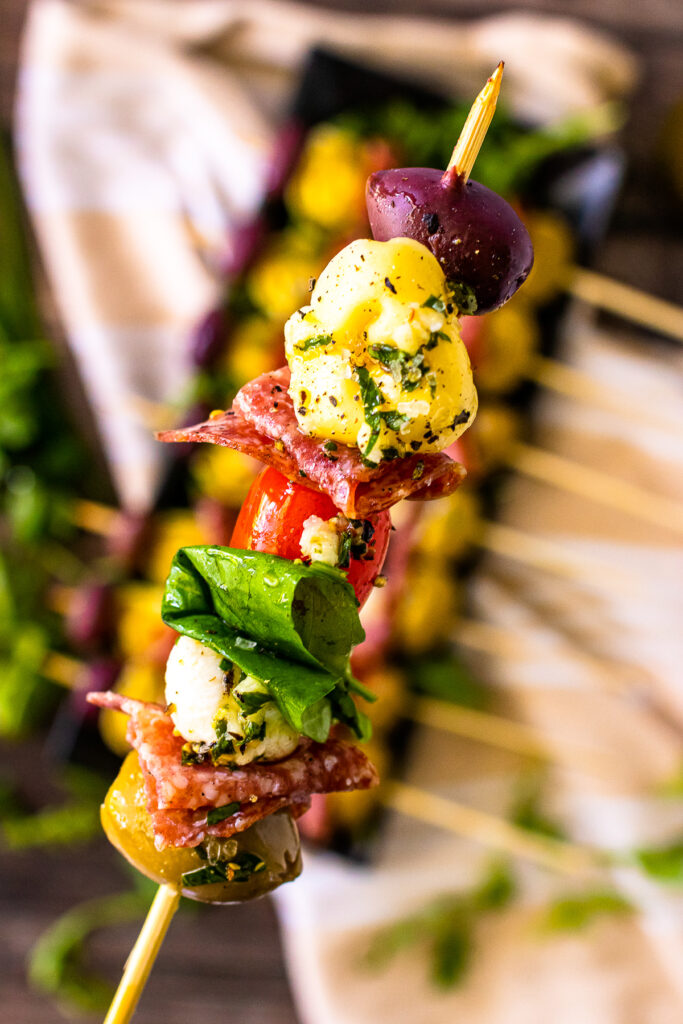 Antipasto skewers upcolse on a stick served as an appetizer.