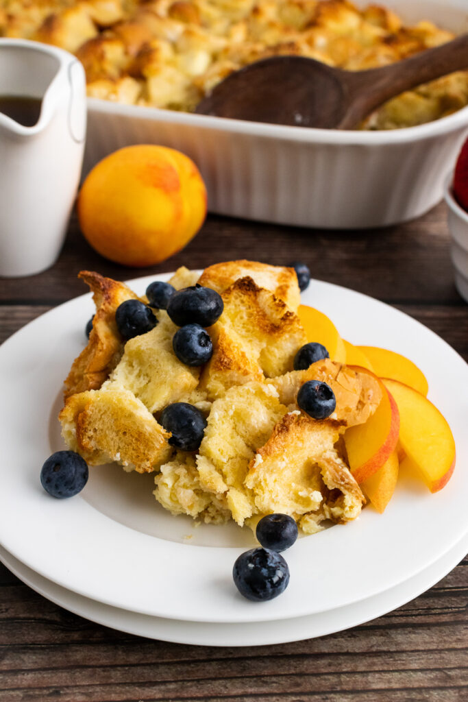 French Toast Bread Pudding with berries and peaches.