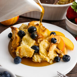 French Toast Bread Pudding with syrup pour.