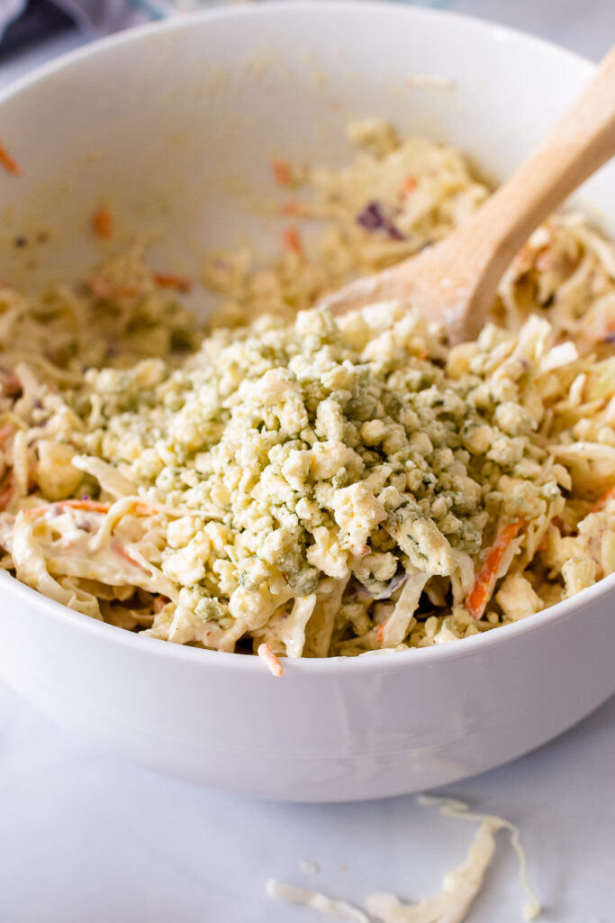 Blue Cheese added to slaw mixture with dressing