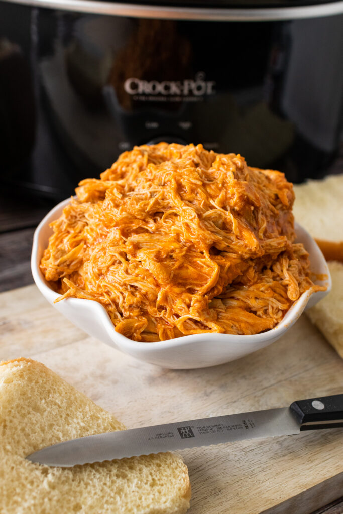 Bowl of Buffalo Chicken that was cooked in the crock pot.