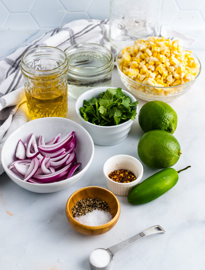 Corn, cilantrol, red onions, jalapenos, limes and spices for Pickled Corn.