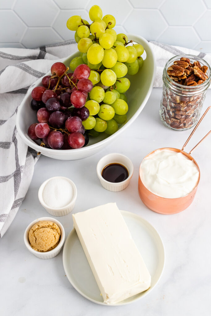 Grapes, pecans, sour cream, cream cheese and brown sugar for Grape Salad.