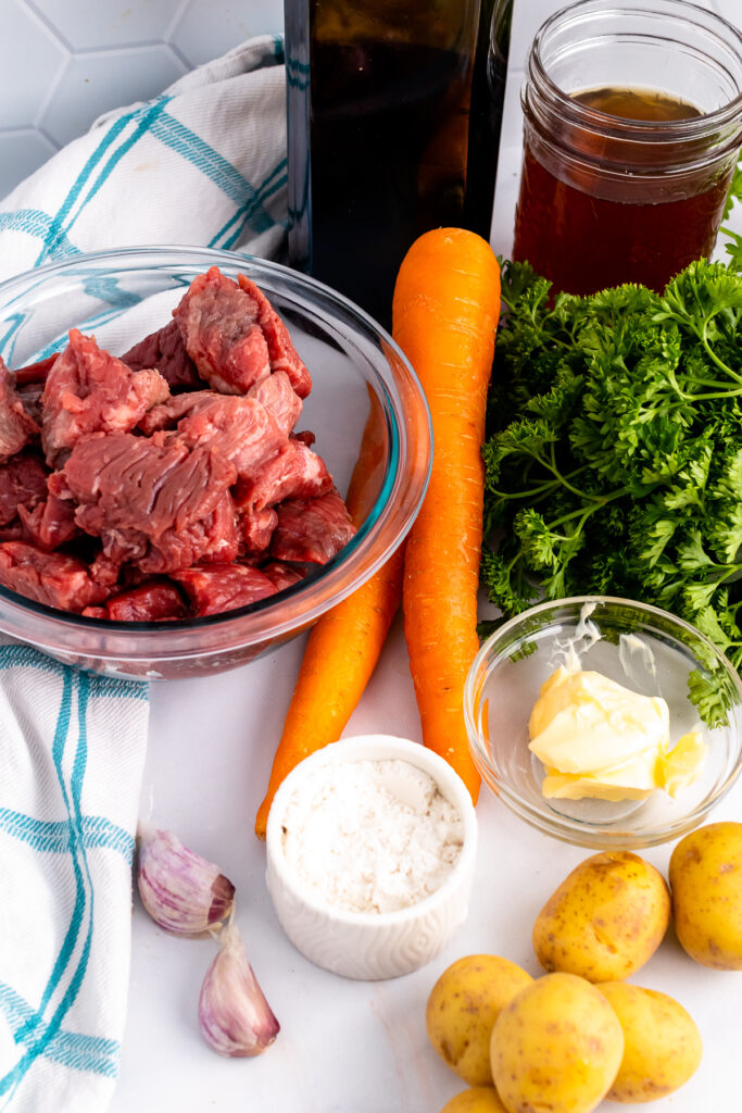 Ingrediets of beef, wine, carrots and potatoes for beef stew