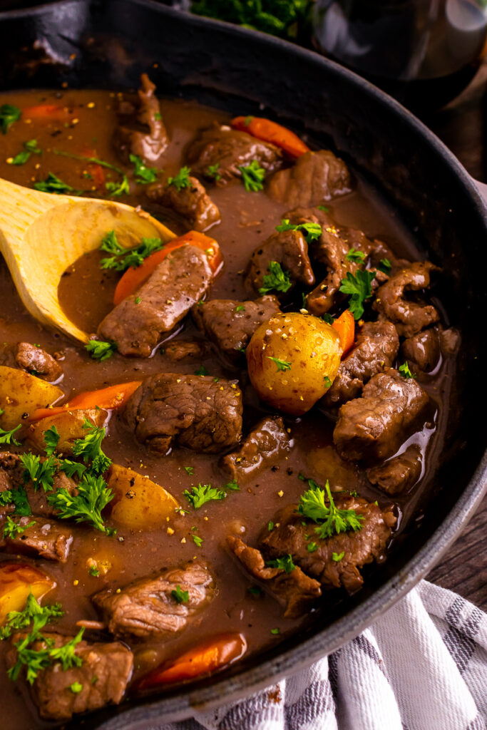 Skillet Beef Stew in a pan with wooden spoon