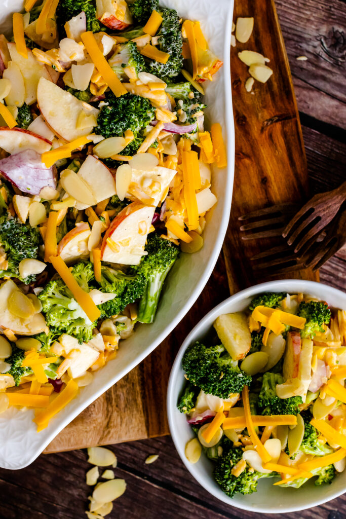 Large white bowl and small white bowl with Broccoli Apple Salad.