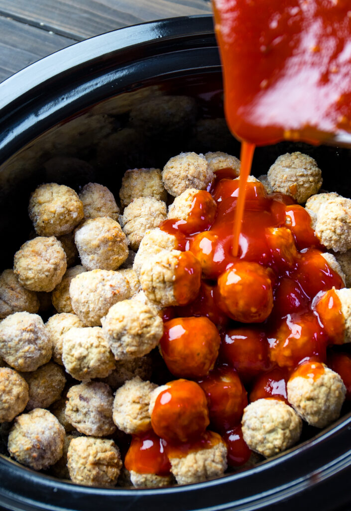 Crock Pot with frozen meatballs with sauce pour over