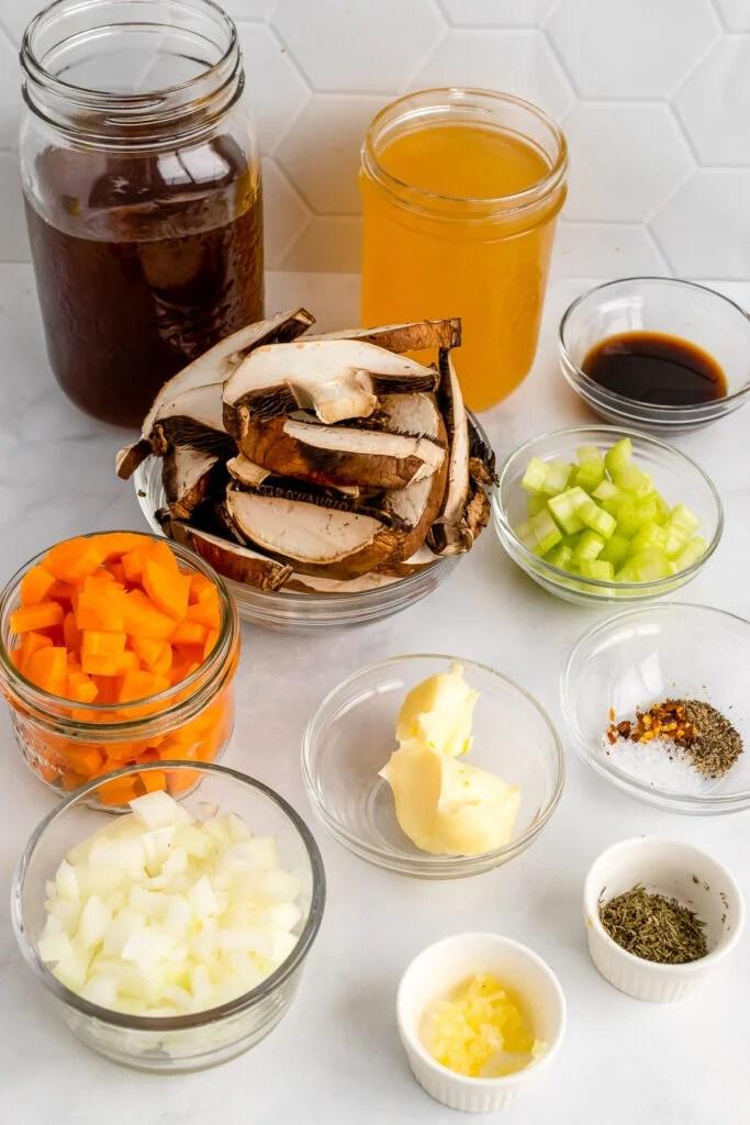 Mushroom, carrots, celery and stock for mushroom soup.