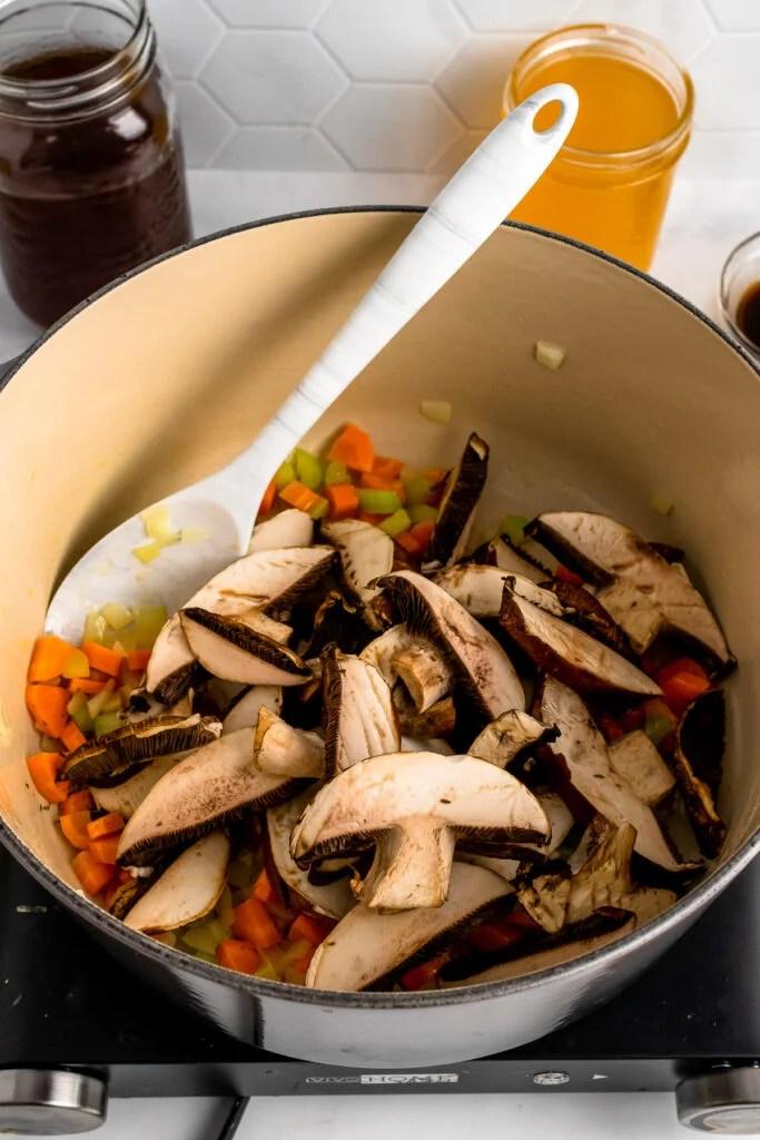 Cut mushrooms in a stock pot for Mushroom Soup