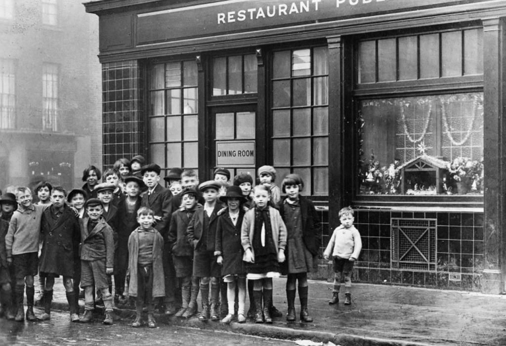 Children outside an old pub in slum.