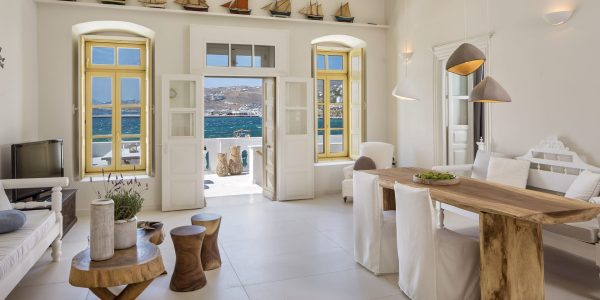Picture taken from the interior of Villa Alexandra, one of the most beautiful and priviliged villas in Mykonos Town, showing part of the living room along with window and door views to the harbor